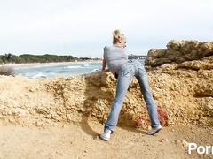 Skinny blonde avidly fucks a huge cock on the beach