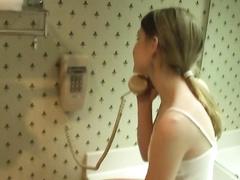 Slutty teen teasing her wet twat in hotel bathroom