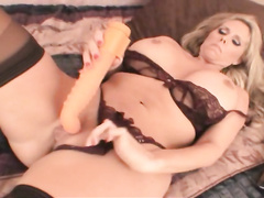 Mature whore in sexy lingerie tries out new dildo