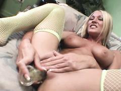 Hot blonde MILF in fishnet dildo fucking her holes