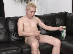 Blonde Asian man balls off in the bright room