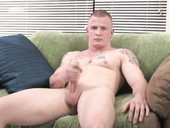 Solo video with muscled man jerking slowly in a chair