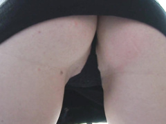 Teenage redhead shows her panties to cameraman