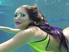 Wonderful mom August Ames with natural chest swims in pool being naked