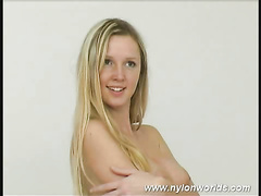 Awesome blonde Katherina strips and teases pussy