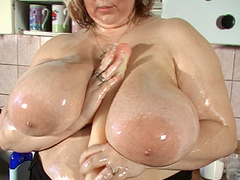 Voluptuous BBW whore playing with tits in kitchen